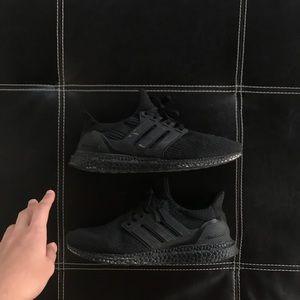 Triple black adidas ultraboost running shoes